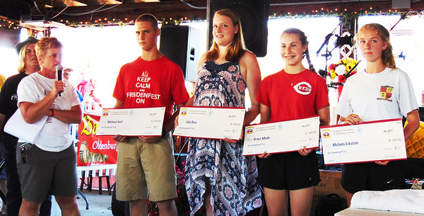 Debbie Blank | The Herald-Tribune<br /> With Karen Munchel (from left) watching, Jackie Wilhelm announced that Freudenfest proceeds funded $1,000 Oldenburg Academy scholarships for Michael Hoff, Julia Rees, Grace Mack and Melinda Eckstein.