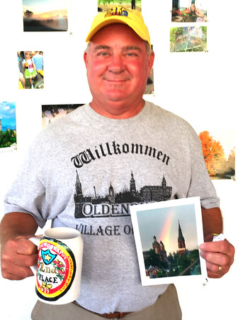 "Submitted photo<br /> Jeff Paul, Oldenburg, won second place, $75 and a beer stein in the fest's photo contest for ""Rainbow Over Spires."""