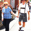 Debbie Blank | The Herald-Tribune<br /> Connie and Dennis Harmeyer stroll on Freudenfest grounds. One obviously wants to win the Dress for the Fest Contest and one doesn't.