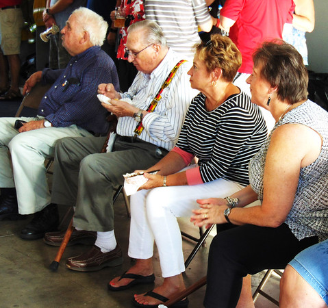 Debbie Blank | The Herald-Tribune<br /> Folks wait patiently for the live auction to get underway.