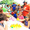 Debbie Blank | The Herald-Tribune<br /> Kids were kept occupied by stilt walkers who juggled and made balloon animals, a variety of treats and games under a tent and on the church lawn.