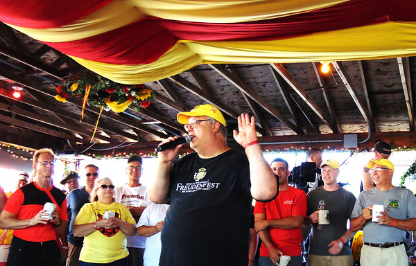 "Debbie Blank | The Herald-Tribune<br /> ""We are a family,"" explained Freudenfest chair Gary Munchel to first-timers, a few from Florida and California, at the opening ceremony Friday, July 14. He detailed the rules: ""Have fun. Have some more fun. Be safe -- but have a lot of fun!"""
