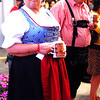 Debbie Blank | The Herald-Tribune<br /> It only makes sense that Melanie and Steve Stahley, who own an Oldenburg brewery, come to Freudenfest. Here they pay close attention to Friday night's auction.