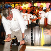 "Debbie Blank | The Herald-Tribune<br /> Like a jack-in-the-box, Gov. Eric Holcomb suddenly appeared during the opening ceremony to tap the keg, much to the delight of attendees. ""Oldenburg rocks!"" he announced. Of the honor of tapping the keg, he said later, ""Everyone has a bucket list. That goes on my barrel list."""