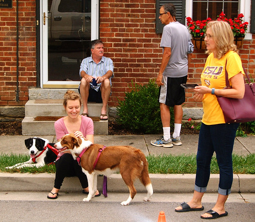 Debbie Blank | The Herald-Tribune<br /> Just before the 5K gets underway, two family members of competitors visit: Sarah Heath (left), Sunman, with border collie mix siblings Lustre and Lady; and Kayla Pinckley, Oldenburg. Chatting behind them are Dave Mannix (left) and Ted Cooley, Batesville.