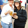 "Debbie Blank | The Herald-Tribune<br /> Friends Liz Kellerman (left), Oldenburg, and Amy Hawkins, Batesville, kick off the weekend with beer July 20 at Freudenfest, which means ""festival of fun."" This summer's theme was ""Come German with Us."""