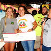 Debbie Blank | The Herald-Tribune<br /> Jackie Wilhelm (from right) presents four $1,000 Oldenburg Academy Freudenfest Scholarships to GiGi Dreyer, Isabella Monroe, Lana Lischkge and Grace Mack, who was absent. The Freudenfest Committee also spends proceeds on projects to improve Oldenburg.