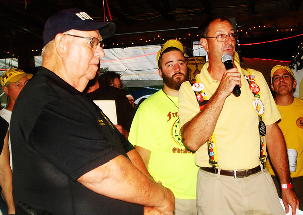 Debbie Blank | The Herald-Tribune<br /> Bill Dramann (left) thought he was at the fest for traffic and people control, but then was called to the shelterhouse for another matter -- to be honored. Fest chair Troy Ilderton discusses why the town marshal is so important to Oldenburg.