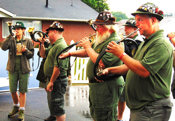 Debbie Blank | The Herald-Tribune<br /> Germania Jagdhorn Blasergruppe (a German hunting horn group) play a tune for free beers Friday night.