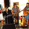 "Debbie Blank | The Herald-Tribune<br /> Hippie Fingers bandmates (from left) Eddie ""Chopper"" Johnson, Sandy Pickett and Brian Creech entertained for an hour before Freudenfest officially opened at 6 p.m. July 20."