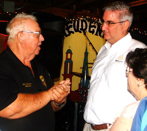Debbie Blank | The Herald-Tribune<br /> The ceremony's cherry on top was a surprise appearance by Gov. Eric Holcomb (center), who chatted with many fest-goers, including Bill Dramann (left) and wife Martha.