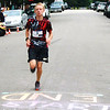 Debbie Blank | The Herald-Tribune<br /> Tyler Kuntz, 15, Batesville, was the second male to cross the finish line at the July 21 race with a 18:22 time.