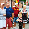 "Debbie Blank | The Herald-Tribune<br /> Kate (from left) and Mike Horrigan, Carmel, and Ralph and Linda Allen with  grandson Brayden Weathers, 5, Katy, Texas, watch the 5K. Linda reported, ""We fly up for Freudenfest,"" a 15-year tradition. Ralph added, ""We enjoy this very much every year, especially the pie auction!"""