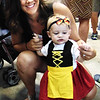 Debbie Blank | The Herald-Tribune<br /> The tiniest German outfit at Freudenfest may have been modeled by Ainsley Hartman, 11 months, New Alsace. With her is mom Lori.
