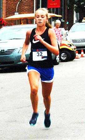Debbie Blank | The Herald-Tribune<br /> Fastest females at the July 21 race were Brenner Hanna (pictured), 15, Greensburg, 19:57; and Lily Pinckley, 15, Oldenburg, 20:49. Swiftest males were Sam Hinnenkamp, 17, Cincinnati, 17:33; and Tyler Kuntz, 15, Batesville, 18:22.