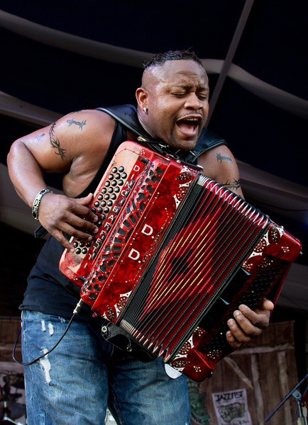 Dwayne Dopsie and the Zydeco Hellraisers perform during the New Orleans Jazz & Heritage Festival 2014 at the Fairgrounds Race Track, New Orleans Louisiana.