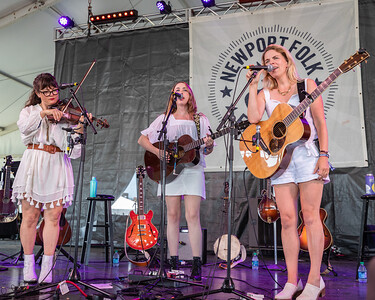 """(L-R) Sara Watkins, Sarah Jarosz, and Aoife O'Donovan of """"I'm with Her"""" perform during the 60th annual Newport Folk Festival 2019 at Fort Adams State Park in Newport RI."""