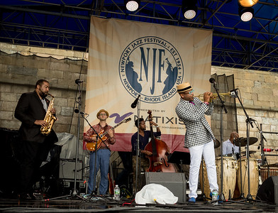 Etienne Charles performs during the Newport Jazz Festival 2016 at Fort Adams State Park in Newport Rhode Island.          Etienne Charles Etienne Charles  - trumpet / Brian Hogans  - alto sax / Alex Wintz – guitar  / Victor Gould - piano / Ben Williams - bass / John Davis - drums