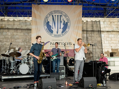 Kneebody Adam Benjamin - keyboards / Shane Endsley - trumpet / Kaveh Rastegar  - bass / Ben Wendel -tenor sax  / Nate Wood – drums performs during the Newport Jazz Festival 2016 at Fort Adams State Park in Newport Rhode Island.