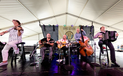 The Djiango Festival All Stars perform during the Newport Jazz Festival 2016 at Fort Adams State Park in Newport Rhode Island. Samson Schmitt – Guitar  Pierre Blanchard - Violin Ludovic Beier - Accodian Phillippe Cuillerier - Guitar Antonio Licusati – Bass