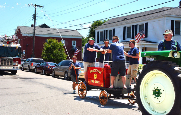 Diane Raver | The Herald-Tribune<br /> Brookville Fire Department members were ready to cool people down.