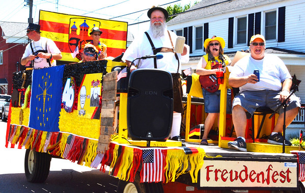 Diane Raver | The Herald-Tribune<br /> Freudenfest float riders entertained with music and let onlookers know the fest will be celebrating its 40th year in July.
