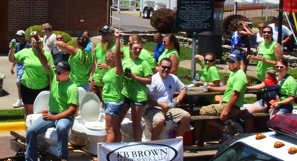 Diane Raver | The Herald-Tribune<br /> KB Brown Septic Service float riders celebrated their win in the best oddity category.