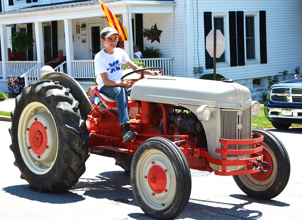Diane Raver | The Herald-Tribune<br /> Many vehicles, including tractors, traveled through the streets of Oldenburg.