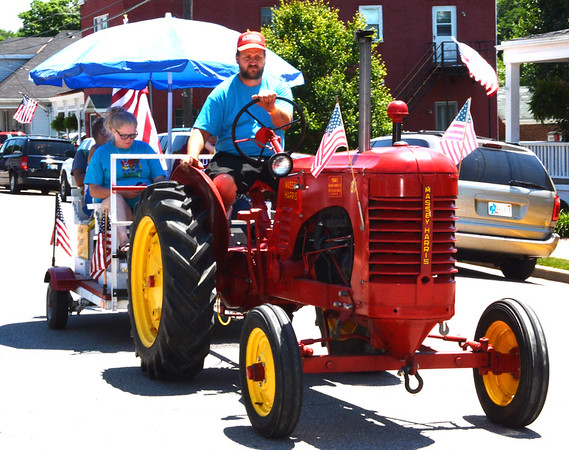 Diane Raver | The Herald-Tribune<br /> Several tractors, including this Massey Harris model, made their way along the parade route.