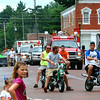 Debbie Blank | The Herald-Tribune<br /> AS THE PROCESSION passed the firehouse on Pearl Street, motorcyclists revved up the crowd.