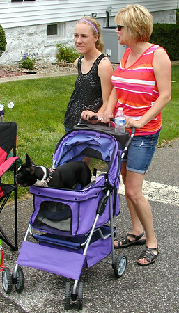 Debbie Blank | The Herald-Tribune<br /> WATCHING the annual parade were Katie (left) and mom Fern Baumer, Batesville, and Boston terrier Cooper.