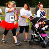 Debbie Blank | The Herald-Tribune<br /> Several tykes in strollers were part of the walking brigade.