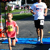 Debbie Blank | The Herald-Tribune<br /> Allie Hayes, 8, and dad Stephen, St. Leon, finished the 5K together.