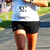 Debbie Blank | The Herald-Tribune<br /> Mary Ann Tighe, West Harrison, ran in honor of her husband, Navy Chief Michael Tighe, who just returned home after a deployment in Kuwait.