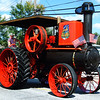 Debbie Blank | The Herald-Tribune<br /> In the procession down State Road 101, owner Sam Ertel, Sunman, with the help of cousin Adam Rynn, Batesville, drove a Gaar-Scott Tiger Thresher Line steam engine that was made in Richmond in 1912. His grandfather bought it in 1935 and Ertel rebuilt the engine in 2012 when it was 100 years old.