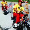 Debbie Blank | The Herald-Tribune<br /> The Southeastern Indiana Shrine Club Crescent Patrol's whizzing cycles entertain the crowd.