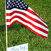 Debbie Blank | The Herald-Tribune<br /> One of dozens of flags near the starting line of the Salute a Soldier 5K in Sunman was placed in memory of Pfc. Anthony Seig. The late Sunman resident and 2005 East Central High School graduate was killed while serving in the U.S. Army's 118th Military Police Co. in Iraq Sept. 9, 2006.
