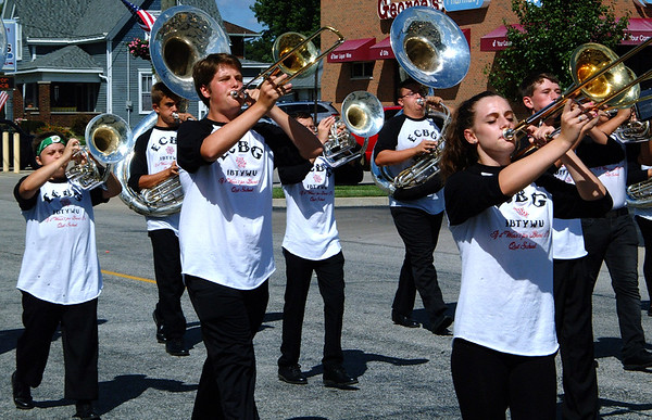 Debbie Blank | The Herald-Tribune<br /> The East Central High School Band was led by colorful flag bearers in the fest's 3 p.m. parade.