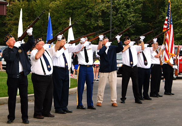 "Debbie Blank | The Herald-Tribune<br /> Kenneth L. Diver American Legion Post 337 members fired three volleys in memory of war dead and ""Taps"" was performed."