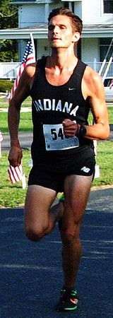 "Debbie Blank | The Herald-Tribune<br /> Sunman native Brad Barry, 24, Terre Haute, was the first to cross the finish line with a time of 15:58. ""I ran past my house twice!"" he reported."