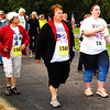 Debbie Blank | The Herald-Tribune<br /> Walkers leave the American Legion post to begin the route. The fastest female walker was Kathy Kramer, 60, Sunman, with a 34:60 time. Byron Wilber, 65, Sunman, was the fastest male walker at 38:52.