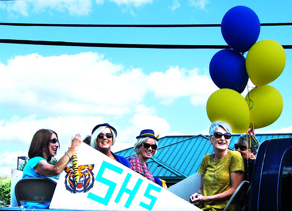 Debbie Blank | The Herald-Tribune<br /> Sunman High School Class of 1974 members rode on a float.
