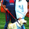 Debbie Blank | The Herald-Tribune<br /> After helping pick grapes for Holtkamp Winery, New Alsace, William Buckley, Hebron, Kentucky; Theresa Burlington, Burlington, Kentucky; and Tuscany, an English cream golden retriever, check out the festival grounds.