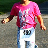 Debbie Blank | The Herald-Tribune<br /> Tatum Johnson, 9, Hidden Valley Lake, was happy to finish the race.