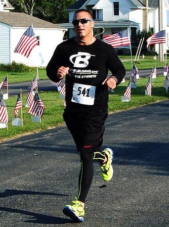 Debbie Blank | The Herald-Tribune<br /> The second fastest male runner was Josh Bushhorn, Greensburg.