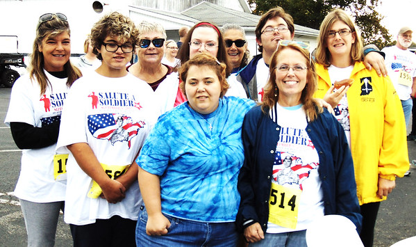 Debbie Blank | The Herald-Tribune<br /> Three members of Girl Scout Troop 5525 plus leader Kim Carr (bottom right), Sunman, walked in the event. Before the race, their moms were there to cheer them on.