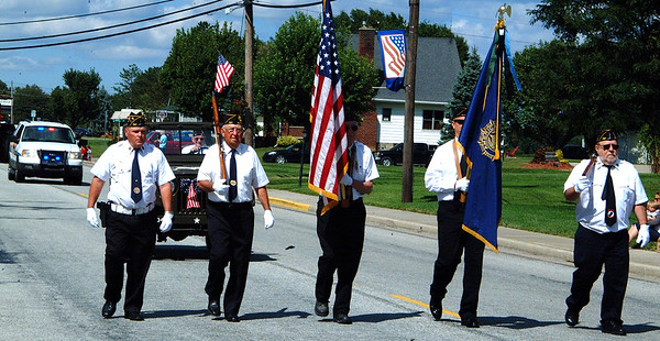 Debbie Blank | The Herald-Tribune<br /> Six hours after helping open the Salute a Soldier 5K, American Legionnaires were back in action at the beginning of the Sunman Area Chamber of Commerce Fall Fest parade Saturday, Sept. 9, at 3 p.m.