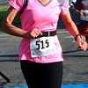 Debbie Blank | The Herald-Tribune<br /> Caron Schwanholt, Milan, crosses the finish line.