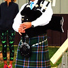 Debbie Blank | The Herald-Tribune<br /> Bagpiper Guy Kern opened the ceremony before the race with a somber tune.
