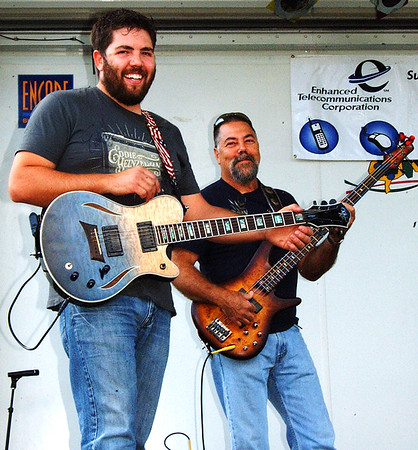 Debbie Blank | The Herald-Tribune<br /> Father-and-son bandmates Andy (right) and Chris Bischoff, St. Leon, warm up before their Yorkridge Boys country set.